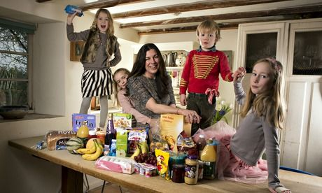 Louise Carpenter at home in Dorset with her children and some of the foods that were essential to their low-sugar diet. Photograph: Richard ...