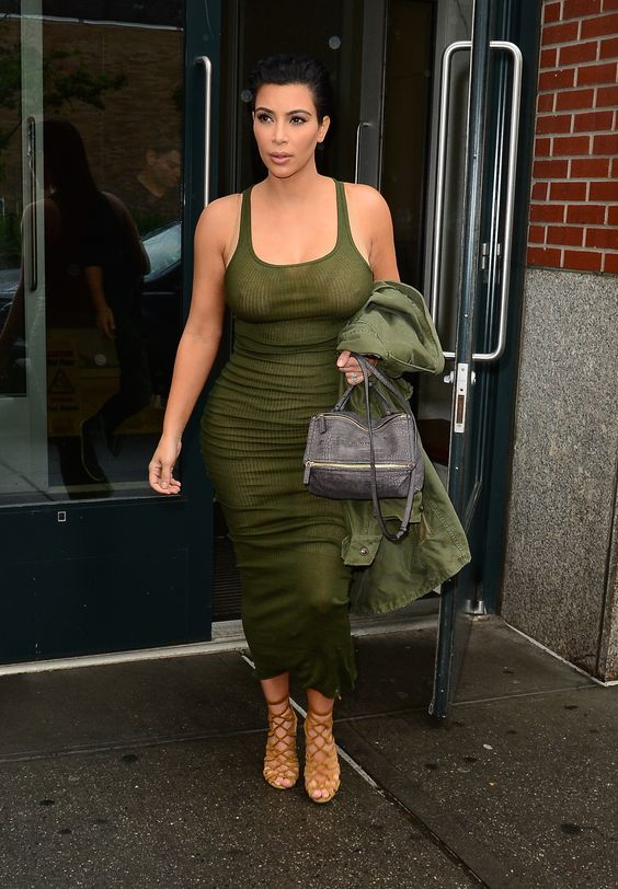 In a Faith Connexion dress and Hermes sandals while leaving her Soho apartment.   - ELLE.com