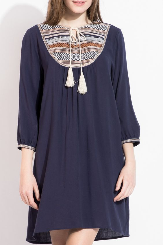 The stunning embroidery on the bib of this THML dress adds the perfect amount of bohemian chic.