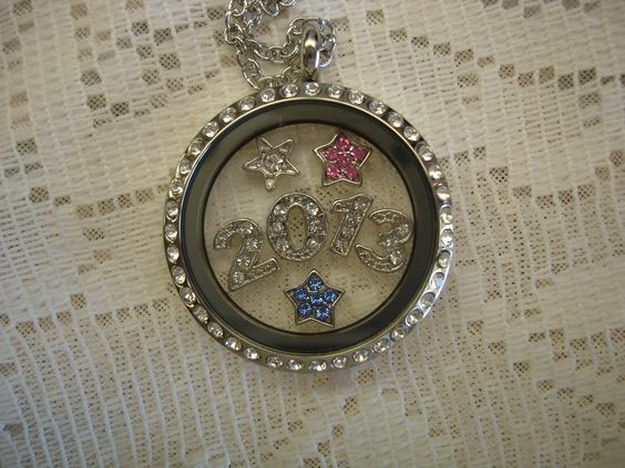 Year with stars in large locket with rhinestones.