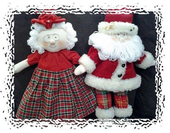 Casal Noel com a Mamãe pronto para enfeitar o natal