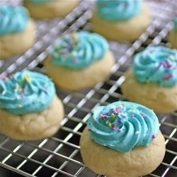 Super soft (almost doughy) sugar cookies with a soft frosting to go with them!