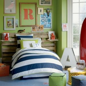Boys room. I like the large rustic headboard and the wall hangings.