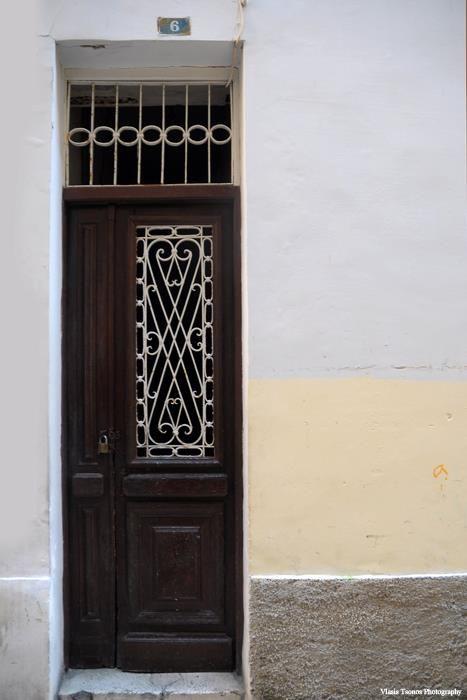 Old doors. By Vlasis Tsonos. Corfu, Greece.
