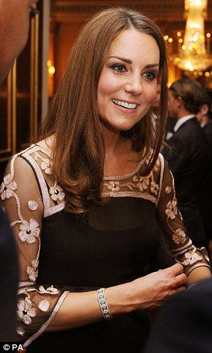Effortlessly beautiful: The Duchess of Cambridge looked elegant in a black gown by Alice Temperley