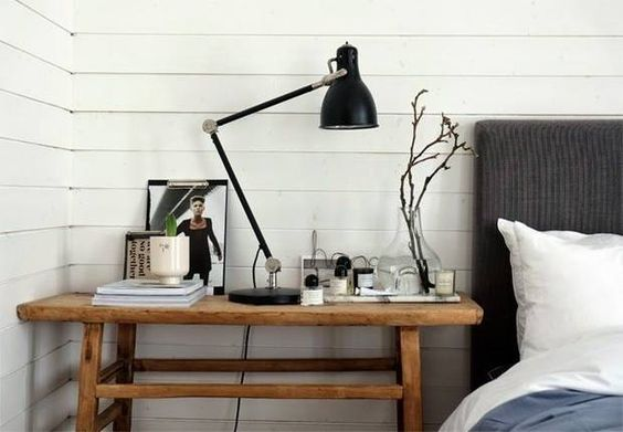 Don't be afraid to buy a larger desk turned nightstand.