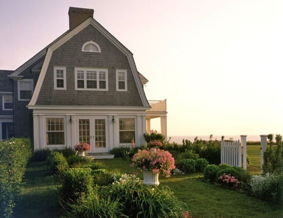 Shingle Style:  I love the soothing colors, the clean lines of the windows and the meandering rooflines.