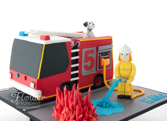 Fire truck birthday cake for a very lucky little 5yo! The truck and fireman's outfit I loosely based on those used by the Qld fire department. The truck is based on a Firepac 3000 Mk 3, made in a more cartoon style to suit a small boy. Complete with a blazing bonfire with the candles in the middle and a cute little Dalmation.