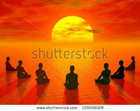 Human sitting in lotus position and meditating in front of the sun by beautiful sunset - stock photo