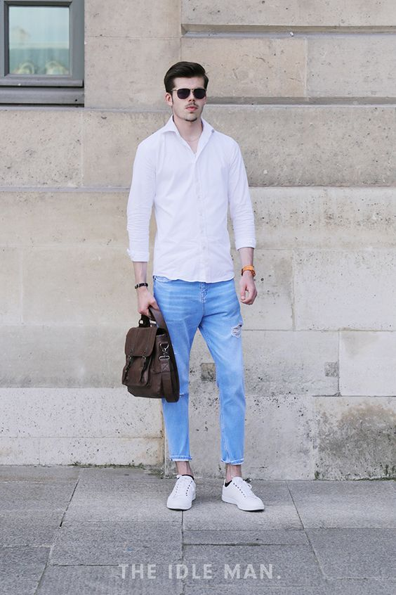 Men's Street Style | Paris Men's Fashion Week| Classy Street Boy - Here at The Idle Man we love a classy shirt turned casual! Roll up the sleeves and where with ripped jeans for that super casual look along with fresh white trainers. Accessorise with a funky watch, a leather satchel and a funky watch for that extra classic street look.| Shop the look at The Idle Man.