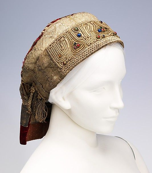 Hat   Russia, late 18th century   Materials: silk, metal, glass   Headdresses, or 'kokoshniks' had the greatest abundance of ornamentation of any type of garment in Russia   They were most often made of damask woven with gilt metallic threads or velvet with gold embroidery. The wealthy peasant class often decorated their kokoshniks with pearls and gemstones   The Metropolitan Museum of Art, New York