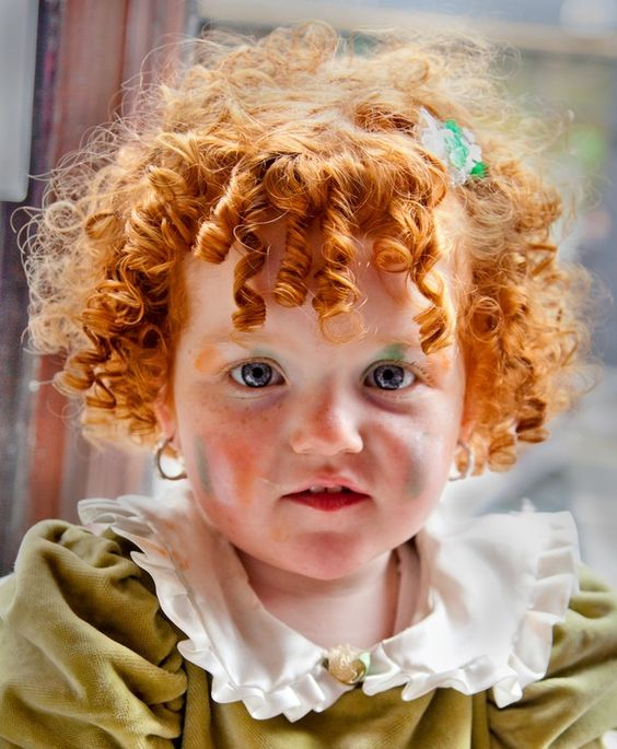 Irish traveller girl in Dublin.  Apple cheeked, ginger curled, cutie!: