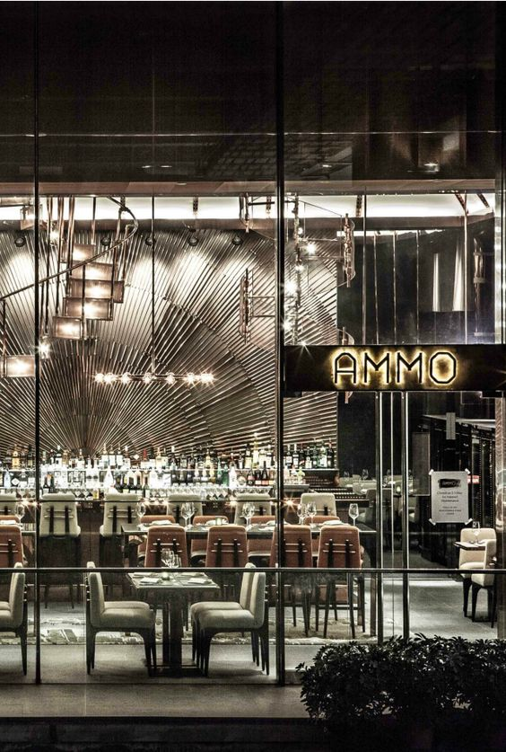 AMMO is a restaurant and bar in Hong Kong, China | Restaurant Interior Design Ideas. Restaurant Dining Chairs. Restaurant Lighting Ideas. Dining Room Chairs. #restaurantinterior #restaurantinteriors www.brabbucontract.com