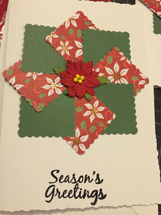 Squares of Christmas paper stuck at angles then a flower made of mulberry paper finished it off