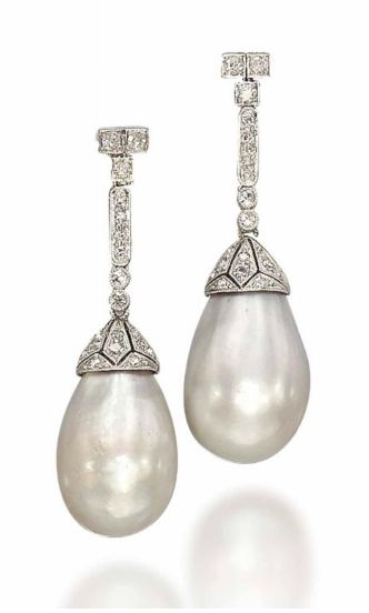 A PAIR OF BELLE EPOQUE NATURAL PEARL AND DIAMOND EAR PENDANTS   The two drop-shaped slightly grey natural pearls, measuring approximately 11.8-13.8 x 20.5 mm and 11.4-13.4 x 19.9 mm, each with a diamond-set openwork cap and suspended from a diamond-set line, 1910s,