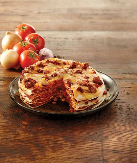 Layer tortillas with ground meat, cheese, and fresh vegetables to make this Mexican Tortilla Stack! #costavida #tortilla