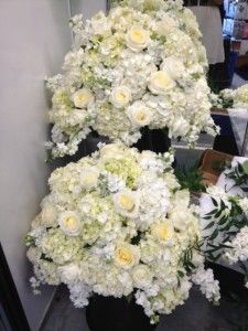 """White wedding centerpieces for the reception as featured on the 1800Flowers' flower blog, Petal Talk post, """"It's a Nice Day for a White Wedding' with White Wedding Flowers."""""""