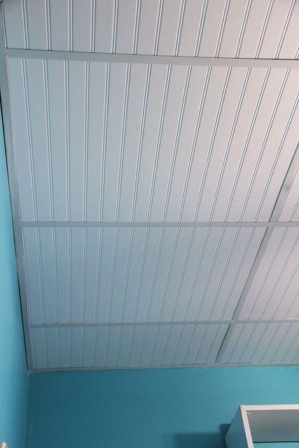dress up a drop ceiling by replacing fiberglass tiles with beadboard