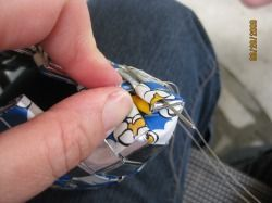Corner of candy wrapper purse