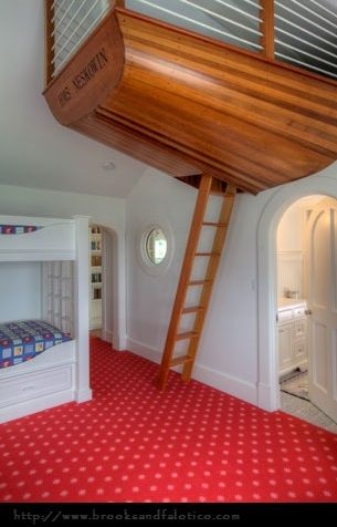 This boat is mounted on the ceiling creating a great loft for the kids bedroom.