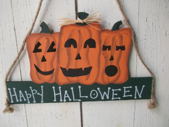 """Halloween Signs Hand Painted """"Happy Halloween"""" or """"Trick-or-Treat"""" 3 Jack-o-Lanterns. $12.00, via Etsy."""