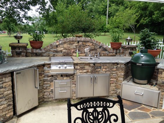 This is a outdoor kitchen with a Big Green Egg
