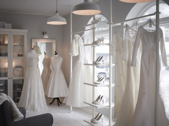 A wedding shop with white display shelves and glass-door cabinets WHITE/ AIRY LOOK OF FLOATING SHELVES