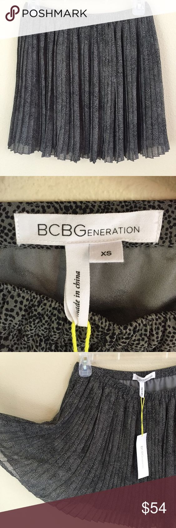BCBGeneration XS Skirt gray animal print NWT New XS BCBGeneration skirt. Fully lined with elastic waist & cute pleats. Light discoloration on inside lining of skirt, isn't seen when worn. BCBGeneration Skirts Mini