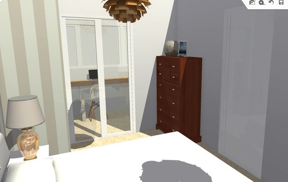 Vista de dormitorio principal hacia ampliación de terraza, a la derecha la puerta corredera empotrada de acceso al baño.
