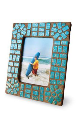 Mosaic frame with hand-made clay tiles (Sculpey or Fimo).  Might do this on the bottom of a wood tray instead of a picture frame.