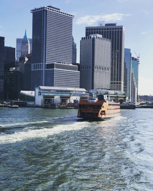1 New York Plaza And 125 Broad Street Loom As The New York City Staten Island Ferry New York