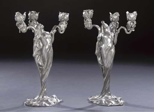 Paire de chandeliers à 3 branches