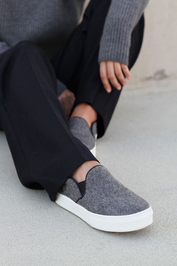 Mija is wearing felt slip-ons from Celine, grey turtleneck and wide leg trousers from Windsor