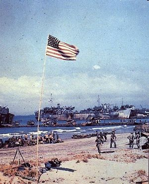 USS LST-555 unloading cargo at the United States Sixth Army beachhead at Lingayen Gulf on Luzon in the Philippine Islands on 9 January 1945.