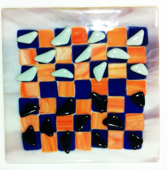 Fused Glass checker board made by middle school student using triangles instead of circular checker pieces. To king the piece it is turned upside down. Great fun!