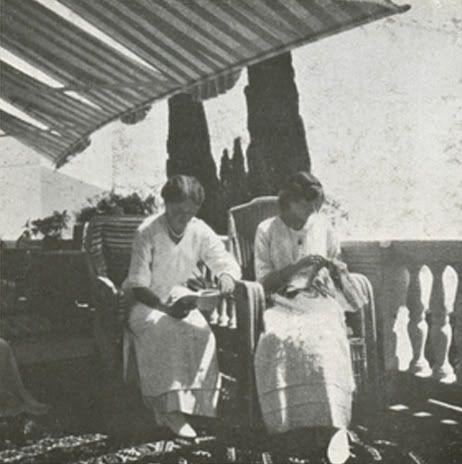 Olga and Tatiana reading on the balcony