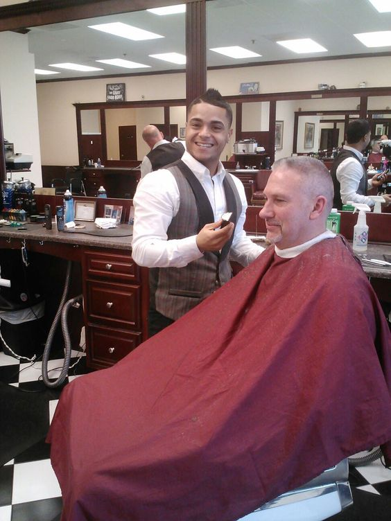 Joell masterfully sculpting another satisfied client at Gino's Classic Barbers