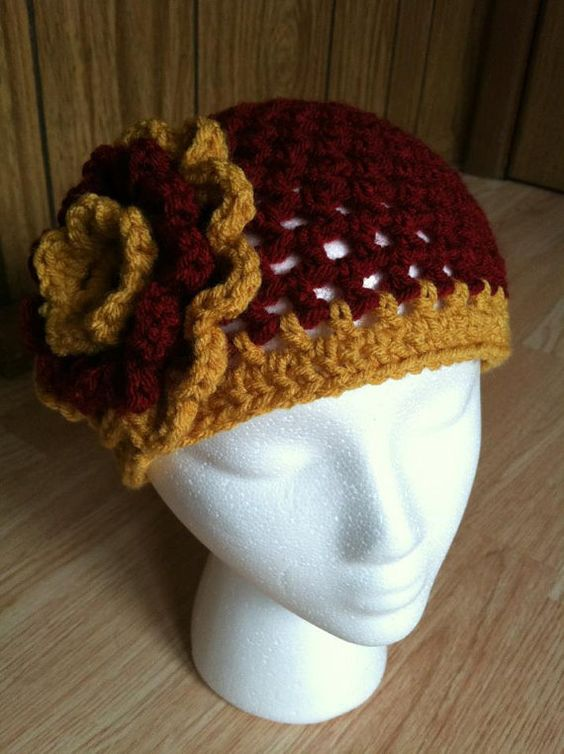 Harry Potter Gryffindor Crochet Adult Flower Hat  by StitchinSally, $18.00. i love that it is a beanie! i may be in slytherin but i love this in griffindor colors! i especially like how the yellow is earth tone and not bright yellow