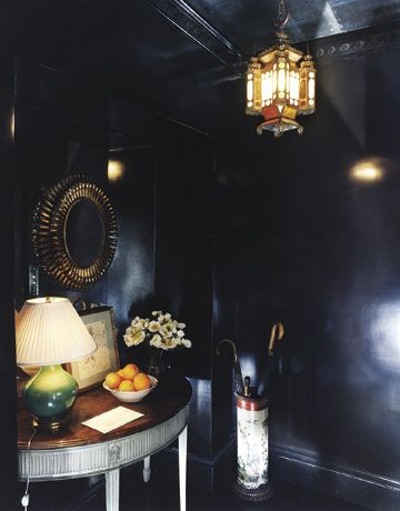 "Daring!!  ""Guests emerging from the elevator find themselves in a jewel box of a hall with dark lacquered walls and floor.""  by Albert Hadley"