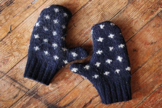 Turn an old wool sweater into a pair of cute and cozy mittens with a little simple sewing.