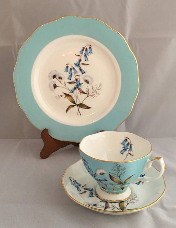 This Tea set was manufactured for Royal Albert's 100 year anniversary, a Royal Doulton company. It features lily of the valley flowers on the teacup, saucer and a dessert plate. Comes in a decorative box lined with foam. Plate measures 8 inches in diameter.