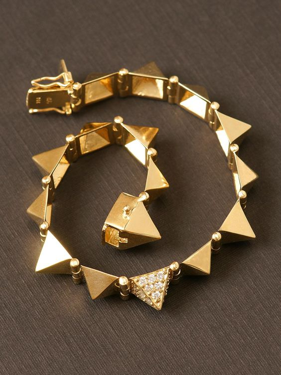 Anita Ko 14k Yellow Gold Large Spike Bracelet. 14k Yellow Gold Spikes with 1 Diamond Spike. 7 inches in Length. $6,600.00