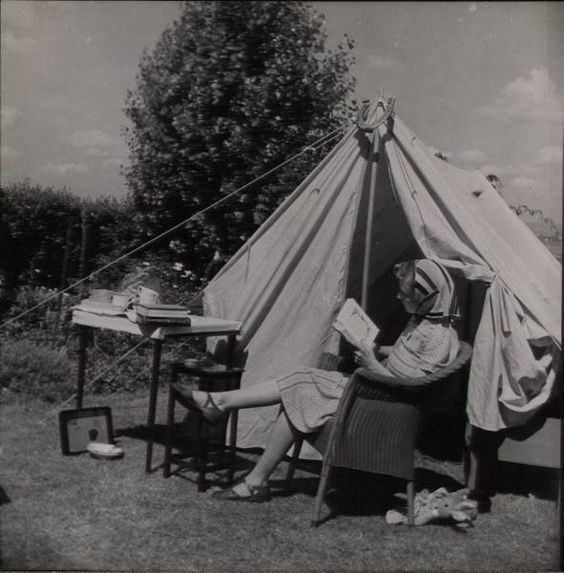 Vintage camping in a summer tent with a wicker chair! 1940s style : )