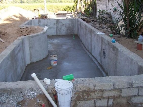 Home built swimming pool building a swimming pool in for Concrete block swimming pool plans