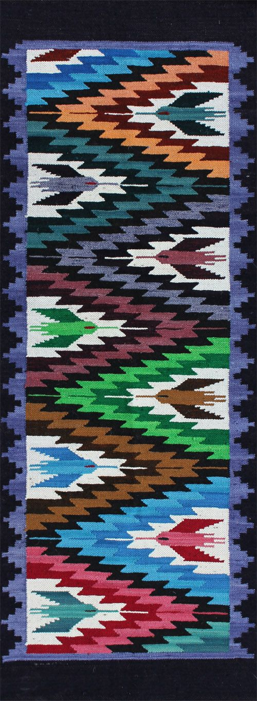 """rug #: 2-104  type:   Peruvian Weaving  origin: Peru  size: 1'10"""" x 5'0""""    This playfully executed hummingbird design uses bright colors to intensify it's delight for life, contrasting the birds with a geometric energy of lightening with zig-zags.  The colors in this electrifying runner could be a great addition to any child's room.    This one of a kind work of art is all handmade with natural materials and vegetable dyes, and was purchased directly from the artisan who produced it."""