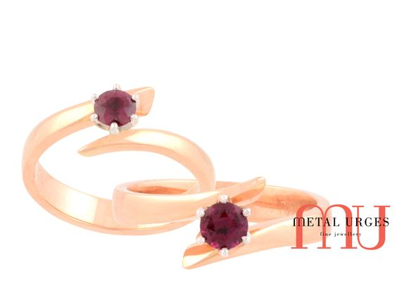 Solitaire ruby ring in a unique setting. 18ct rose and white gold. Handmade in