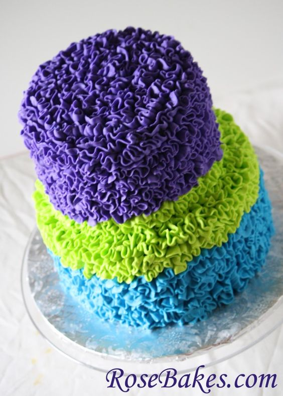 Messy Ruffles Buttercream Cake with Peacock Colors `