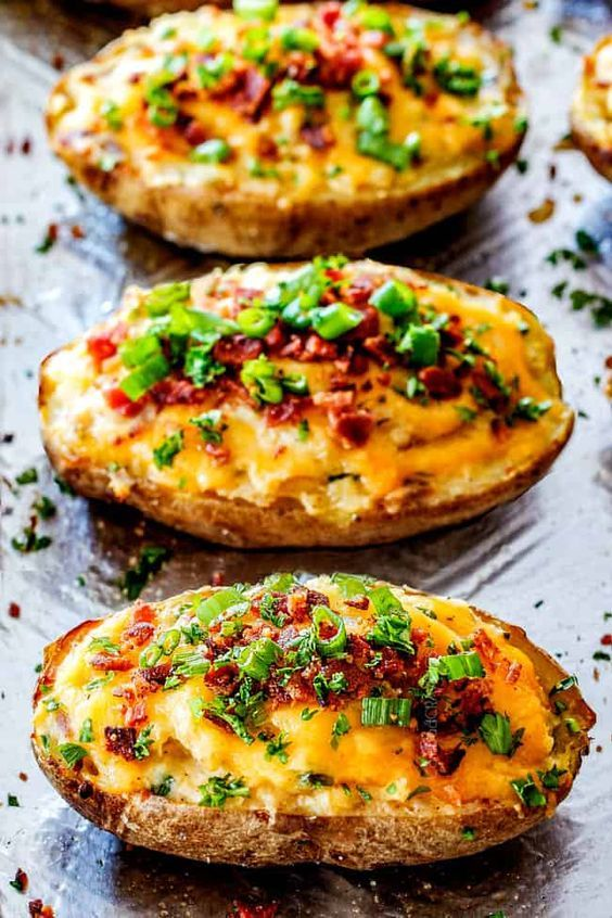 Easy Twice Baked Potatoes With Sour Cream Butter Cheese And Bacon On A Baking Sheet Baked Potato Recipes Easy Twice Baked Potatoes Brunch Recipes
