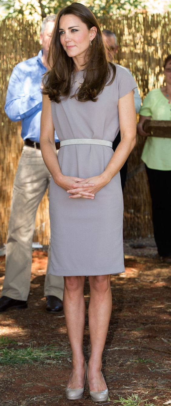 Kate Middleton made a conservative choice of a belted gray sheath while visiting the National Indigenous Training Academy in Australia.