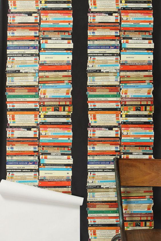 Stacked paperback wallpaper -- Clutter as decor or pretend library